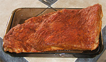 Beef brisket with dry rub ready for smoking.